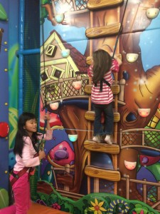 Conquering the kiddie climbing wall together.